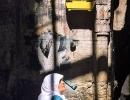 An Arab woman walks below a bird cage in the Arab district, Jerusalem.