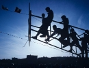 Kids climb on a broken basketball hoop, Duro.