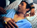 A boy recovers from a rubber bullet wound in Ramallah.
