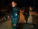 Palestinians stop traffic at a Ramallah checkpoint.