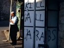 An Arab stands outside his Hebron shop.